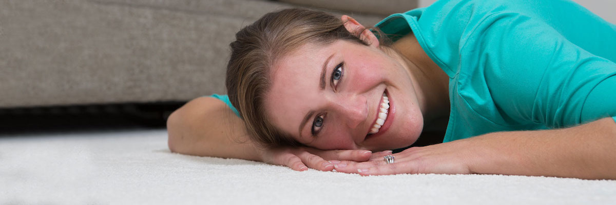 Woman Laying On A Clean Carpet After Stain Removal