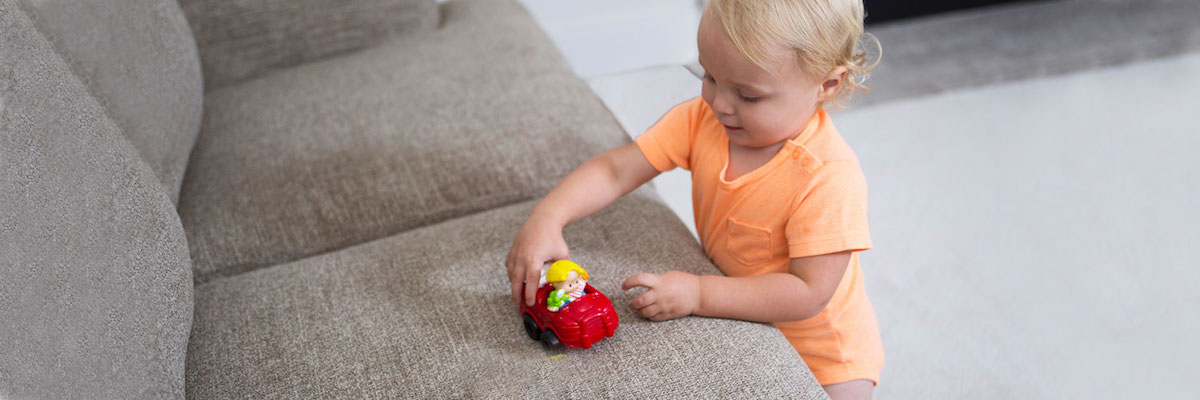 Child Playing With Toy On Couch Cleaned by Clawson Chem-Dry in Severn & Annapolis